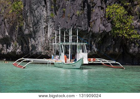 EL NIDO PHILIPPINES - FEBRUARY 04 2014 : Boats waiting for tourists to travel between the islands. El Nido is one of the top tourist destinations in the world.