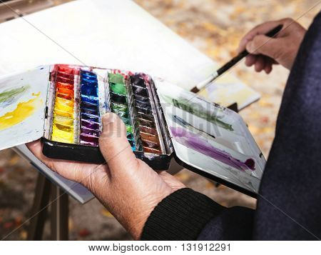 Artist painting watercolours People Leisure lifestyle outdoor