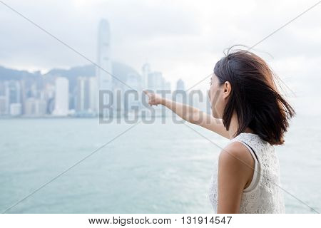 Woman looking far away in the Victoria harbor