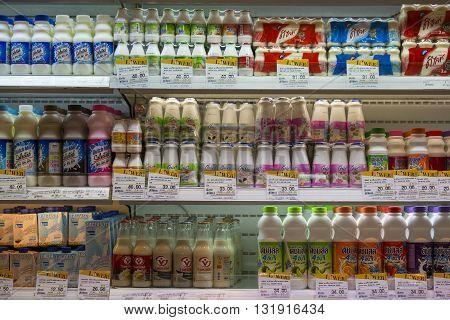 BANGKOK THAILAND - NOVEMBER 18 2013 : Selection of yogurts soy milk and milk on the shelves in a supermarket Siam Paragon in Bangkok Thailand.