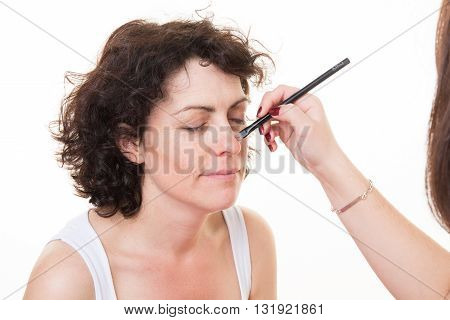 Happy Middle-aged Model, Which Is Applied Makeup. Makeup Artist