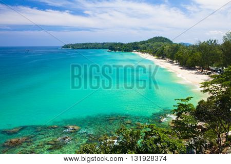 Surin Beach with large boulders in Phuket Thailand
