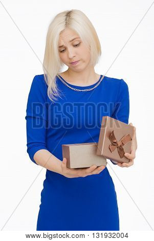 Young woman portrait unfortunate to opening gift
