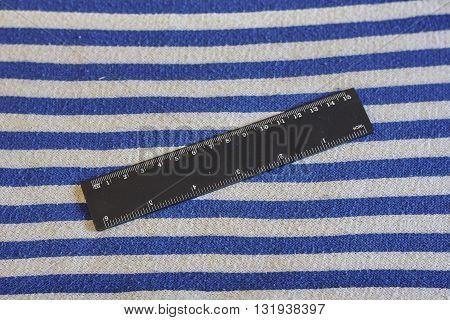 black inch cm ruler on blue white striped vest