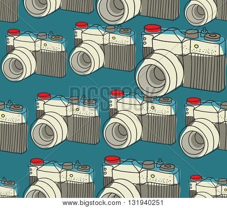 Seamless pattern with old photo cameras. Vector repeated background.