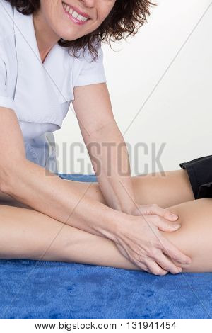 Tight Of A Female Massaging By Therapist