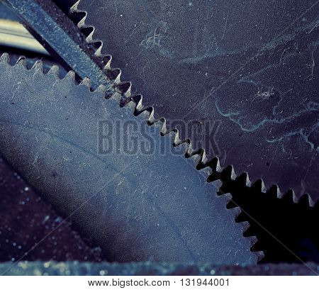 Collaboration of two gear wheels macro photo