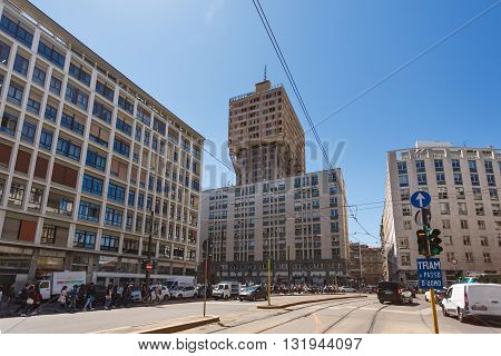Milan Italy - May 04 2016: View of the Larga street with the Velasca tower on the background the first skyscraper in Milan downtown
