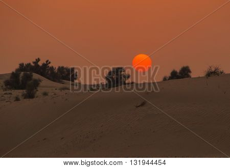 view on sunset in desert near Dubai
