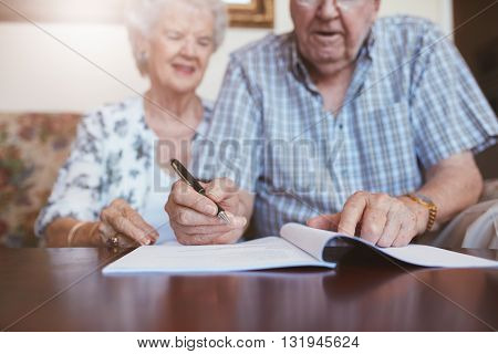 Senior Couple Signing Their Will Documents