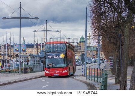 STOCKHOLM SWEDEN - MARCH 30 2016: Red bus transport tourists in the center of Stockholm Sweden