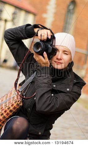 Beautiful girl with a digital camera