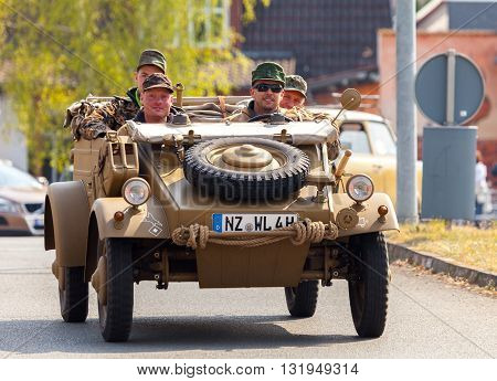 ALTENTREPTOW / GERMANY - MAY 1 2016: german kubelwagen vw typ 82 drives on an oldtimer show in altentreptow germany at may 1 2016.