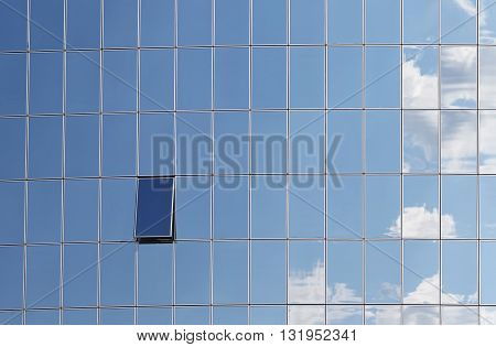 Sky reflected in windows of modern office building