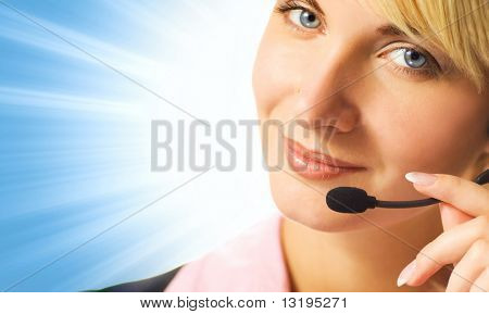 Friendly phone operator on blue abstract background