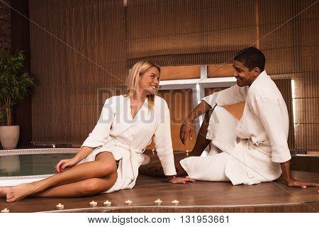 Couple wearing bathrobe enjoying day at the spa.