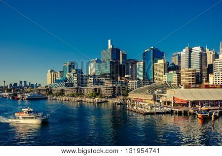 Sydney Australia - September 14 2012: Beautiful Darling Harbor skyline with boats at sunset. Darling Harbour is a large recreational and pedestrian precinct that is situated on western outskirts of the Sydney CBD