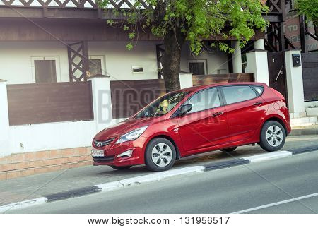 MUNICH, GERMANY - APRIL 29 2016: A red Hyundai Solaris parked in the streets of Munich. New korean car.