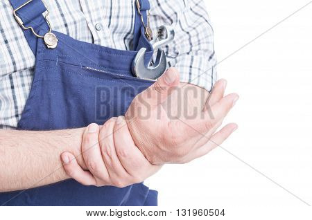 Close-up Of Repairman Holdig His Wrist In Pain