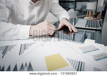Marketing Time Management. Work process.Photo Trader working Market Report Documents Touching Tablet, Reflections Screen.Using Graphics, Stock Exchanges Reports. Business Project Startup. Horizontal