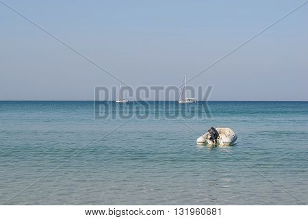 Dinghy on water sea beachLayan beach in PhuketThailand