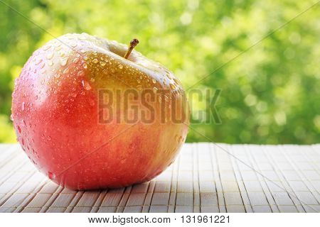 Apple On Green Background
