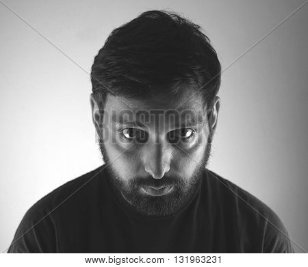 Mad evil serious man looking isolated B&W