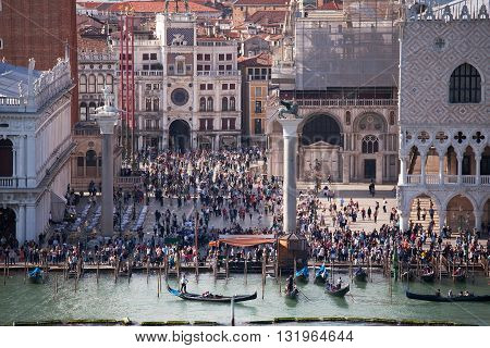 VENICE, ITALY -  MAY 14 2016 : Morning crowds gather in Piazza San Marco.