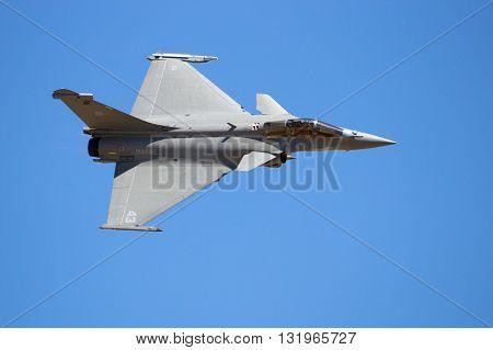 ZARAGOZA SPAIN - MAY 20 2016: French Navy Dassault Rafale fighter jet flyby on a blue sky