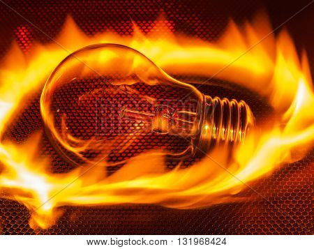 Hot incandescent lamp in fire. Incandescent filament lamp may cause fire