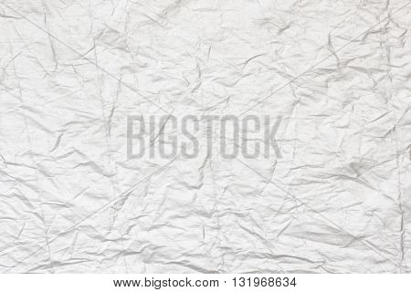 Abstract art white creased paper background texture.