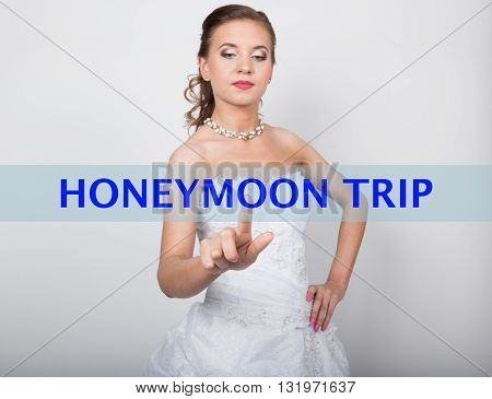 technology, internet and networking concept. Beautiful bride in fashion wedding dress. Bride presses honeymoon trip button on virtual screens