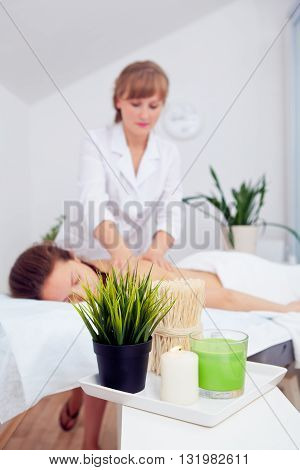 Spa Woman. Beauty Treatment. Beautiful Healthy Caucasian Girl Relaxing On Massage Table Before Procedure In The Spa Salon. Masseur Going To Massage Her Back. Body Care. Skin Care, Wellness, Wellbeing.