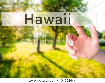 Hawaii - Hand Pressing A Button On Blurred Background Concept On Visual Screen.