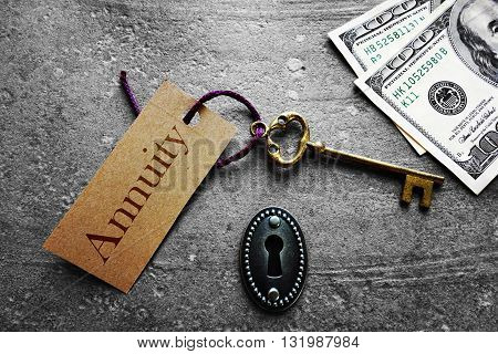 Gold key with Annuity tag with keyhole and cash