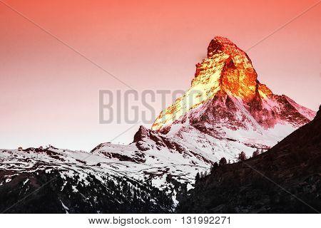 Golden sunlight shine on Matterhorn in early morning Zermatt Switzerland