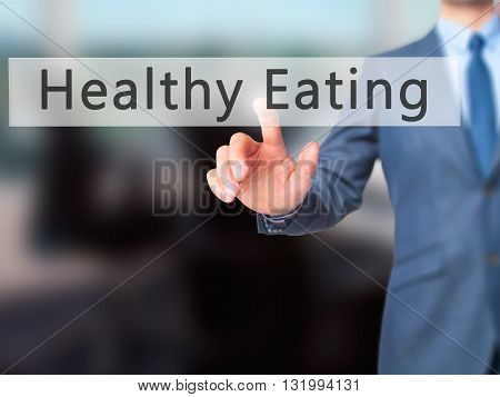 Healthy Eating - Businessman Hand Pressing Button On Touch Screen Interface.