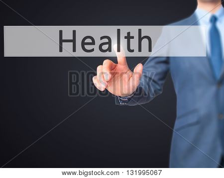 Health - Businessman Hand Pressing Button On Touch Screen Interface.
