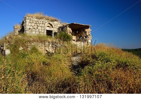 Ancient abandoned and ruined building in Latrun monastery area. Central Israel.