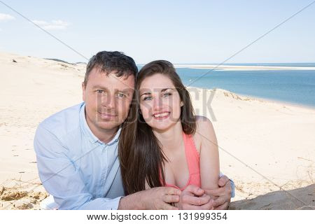 Happy And Loving Couple Smiling At The Beach