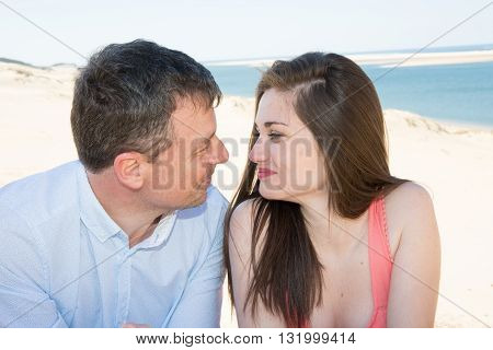 Loving Couple Smiling At Each Other With Love