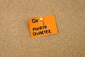 Q4 as FOURTH QUARTER written on orange paper note pinned on cork board with white thumbtacks copy space available poster