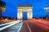 Arc de Triomphe at night in Paris France poster