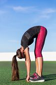 Standing forward bend yoga pose stretch fitness woman doing toe touch legs exercise. Girl stretching for lower back pain and flexibility by touching feet exercises in summer outdoors on grass park. poster