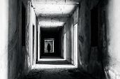 walkway in Abandoned building with scary woman inside darkness horror and halloween background concept poster