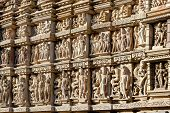 Ancient erotic bas-relief in Khajuraho temple, India. poster