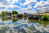 Rows of houseboats and narrow boats on the canal banks at St Pancras Yacht Basin part of the Regent's Canal in London poster