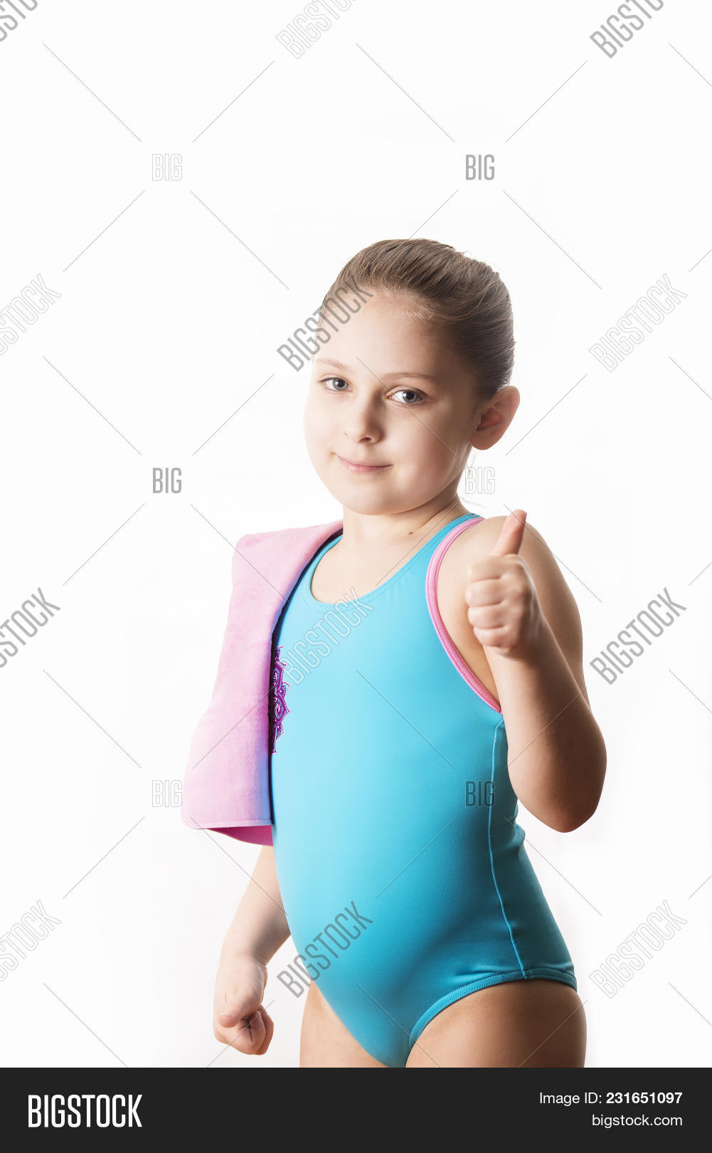 9c45dfe4d16 Swimmer: Little 7 Years Old Cute Caucasian Girlie In Cyan Swimming Costume  With Pink Shammy