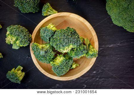 Beautiful Broccoli Florets On A Wooden Plate On A Slate Board