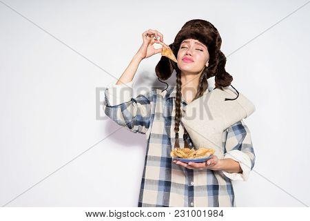 Funny Young Russian Girl Celebrates Maslenitsa, Eats Hot Delicious Pancakes
